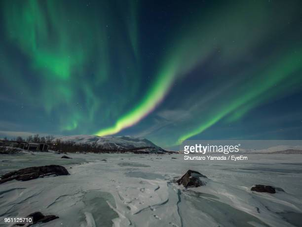 Scenic View Of Frozen Landscape Against Sky At Night