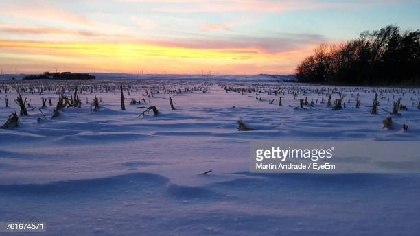 Scenic View Of Frozen Landscape Against Sky During Sunset