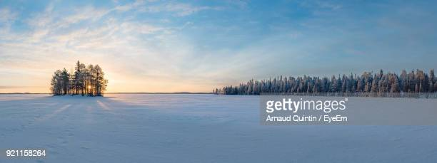 scenic view of frozen landscape against sky during winter - winter sky stock pictures, royalty-free photos & images