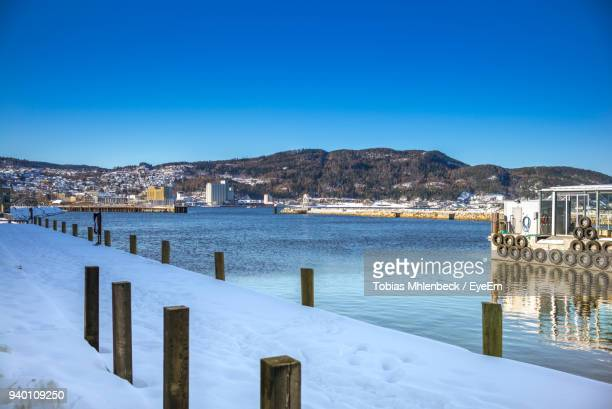 Scenic View Of Frozen Sea Against Clear Blue Sky