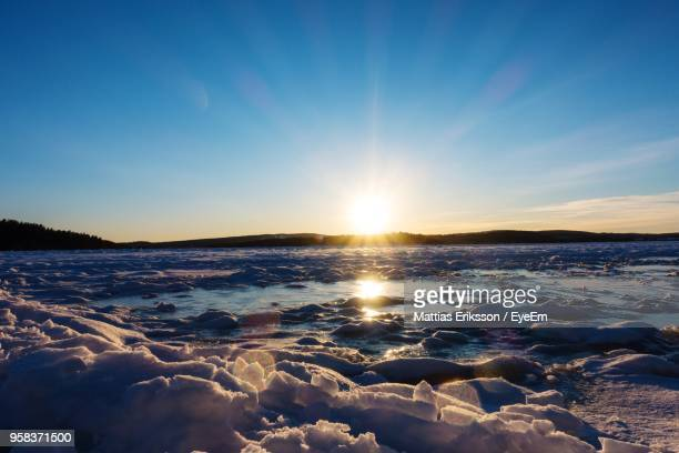 scenic view of frozen sea against sky during sunset - ファールン ストックフォトと画像