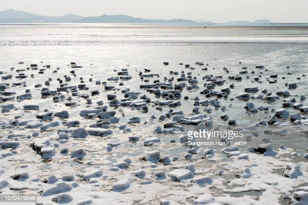 scenic view of frozen sea against sky - gwangju stock pictures, royalty-free photos & images