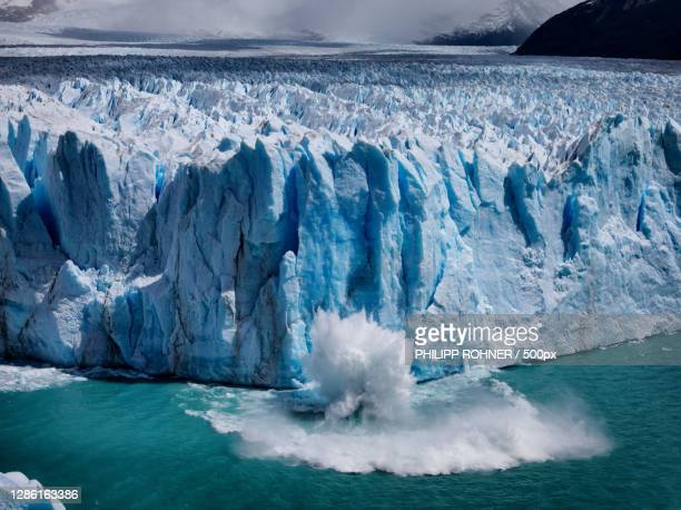 scenic view of frozen sea against sky - glacier stock pictures, royalty-free photos & images