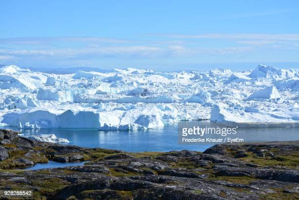 scenic view of frozen sea against sky - greenland stock pictures, royalty-free photos & images