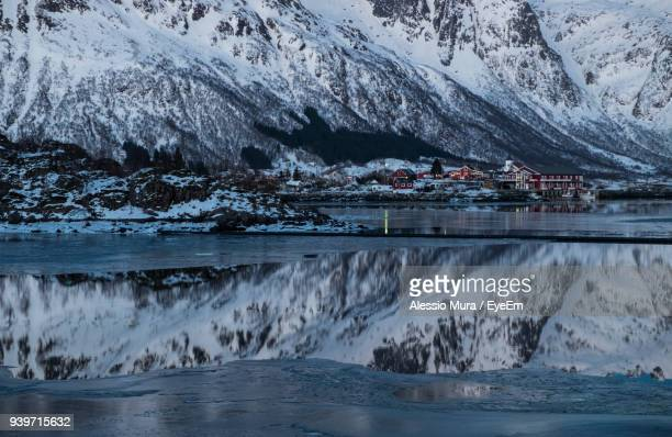 Scenic View Of Frozen Sea Against Snowcapped Mountain