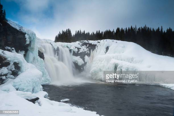 Scenic View Of Frozen Waterfall Against Sky