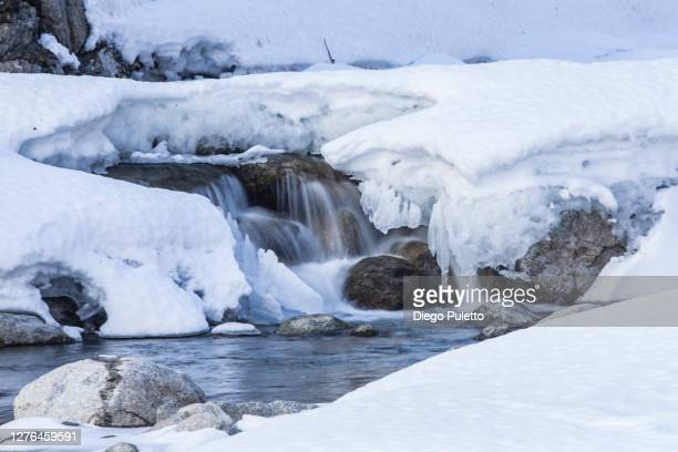 scenic view of frozen waterfall - puletto diego stock pictures, royalty-free photos & images