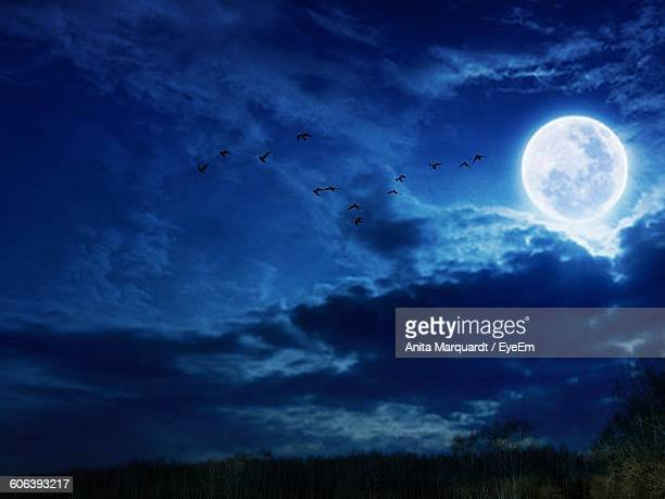 Scenic View Of Full Moon In Cloudy Sky During Dusk