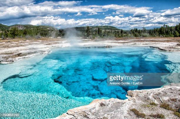 Scenic View Of Geyser And Mountain Against Sky