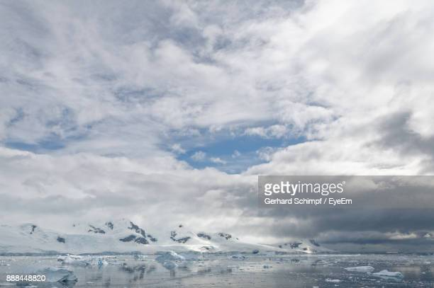 scenic view of glacier against sky - gerhard schimpf stock pictures, royalty-free photos & images