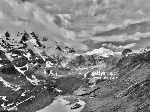 scenic view of glacier and snowcapped mountains against sky - gerhard hagn stock-fotos und bilder