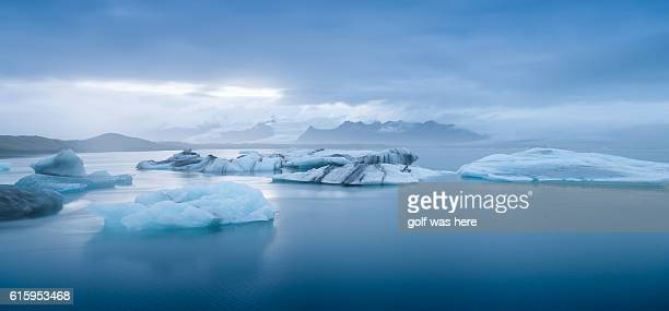 scenic view of glacier lagoon in jokulsarlon lake against sky - iceberg ice formation stock pictures, royalty-free photos & images