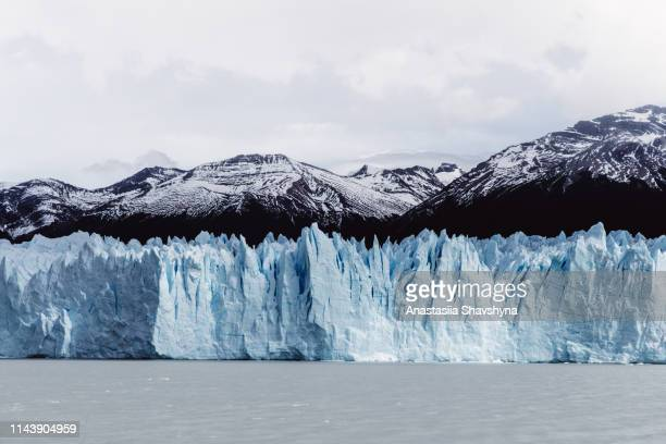 scenic view of glacier perito moreno in argentina - glacier collapsing stock pictures, royalty-free photos & images