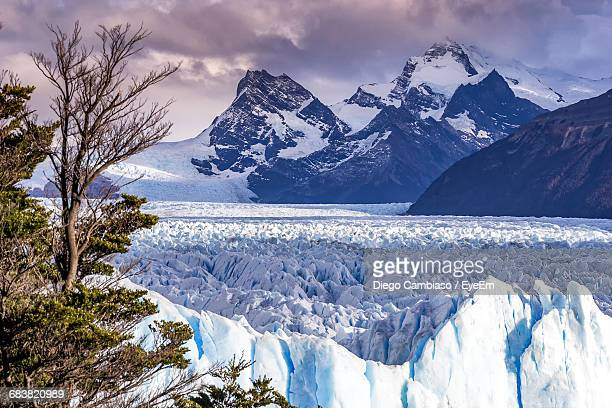 Scenic View Of Glacier With Snow Covered Mountains