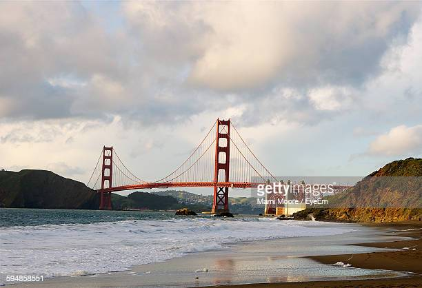 Scenic View Of Golden Gate Bridge Against Cloudy Sky