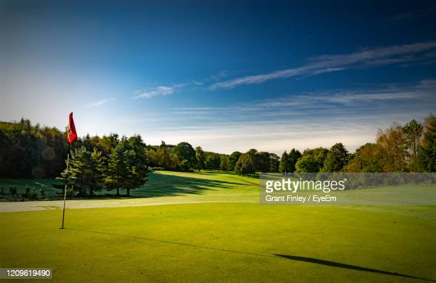 scenic view of golf course against sky - golf stock pictures, royalty-free photos & images