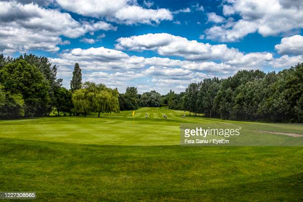 scenic view of golf course against sky - golf course stock pictures, royalty-free photos & images
