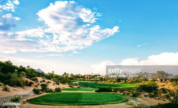 scenic view of golf course against sky - casey nolan stock pictures, royalty-free photos & images