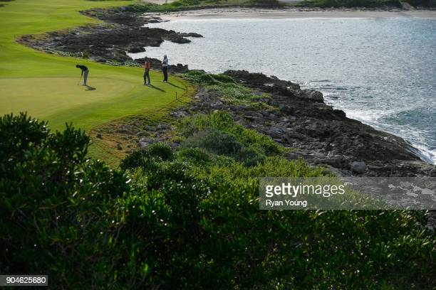 A scenic view of golfers putting on the 12th hole during the first round of the Webcom Tour's The Bahamas Great Exuma Classic at Sandals Emerald Bay...