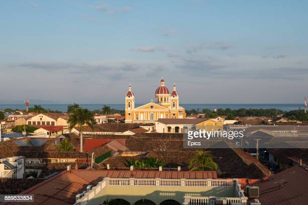 A scenic view of Granada cathedral seen in the distance from Iglesia La Merced church bell tower Granada Nicaragua