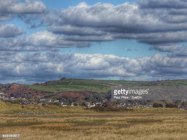 scenic view of grassy field against sky - llanelli stock pictures, royalty-free photos & images