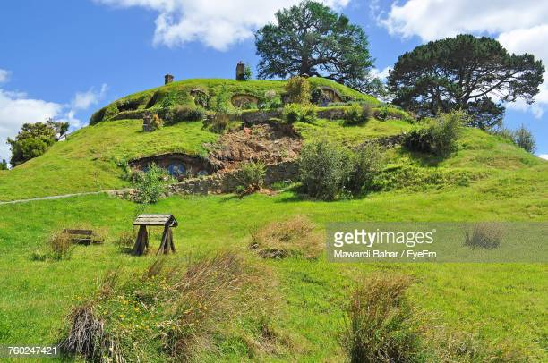 Scenic View Of Grassy Hill Against Sky At Matamata