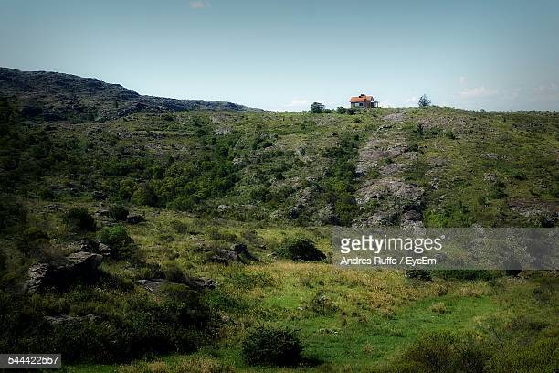 scenic view of grassy hills against sky - andres ruffo stock pictures, royalty-free photos & images