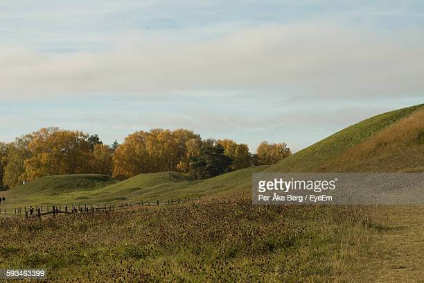Scenic View Of Grassy Hills Against Sky