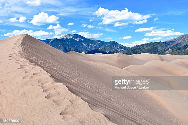 scenic view of great sand dunes national park and preserve against sky - great sand dunes national park stock pictures, royalty-free photos & images