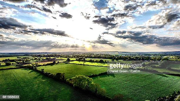 scenic view of green landscape against sky - aylesbury stock photos and pictures