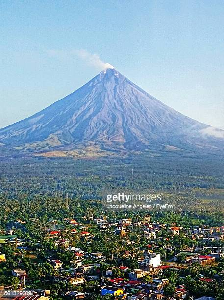 Scenic View Of Green Landscape And Mayon Volcano Against Sky