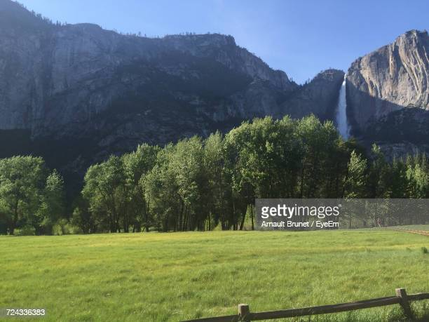 scenic view of green landscape and mountains against sky - arnault stock pictures, royalty-free photos & images
