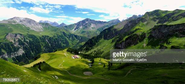 scenic view of green landscape and mountains against sky - principality of liechtenstein stock pictures, royalty-free photos & images