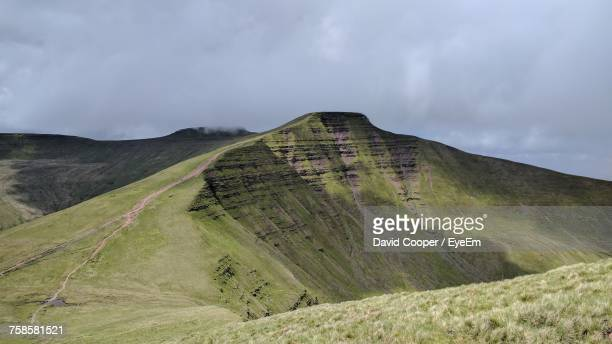 Scenic View Of Green Landscape At Brecon Beacons National Park Against Cloudy Sky