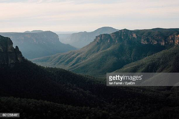 scenic view of green mountain ranges against sky - mountain range stock pictures, royalty-free photos & images