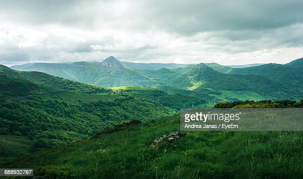 scenic view of green mountains against cloudy sky - auvergne rhône alpes stock pictures, royalty-free photos & images
