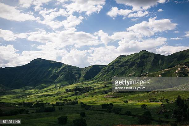 scenic view of green mountains against sky - maseru stock photos and pictures