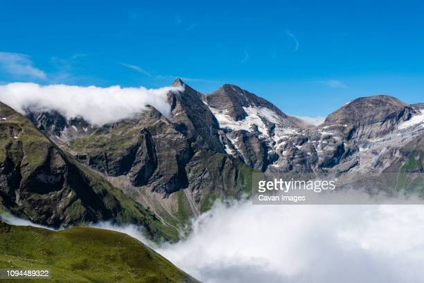 Scenic view of Grossglockner against blue sky during sunny day