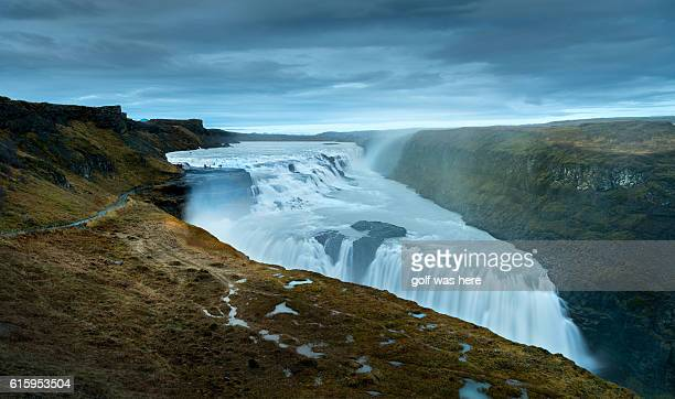 scenic view of gullfoss falls against cloudy sky - gullfoss falls stock photos and pictures
