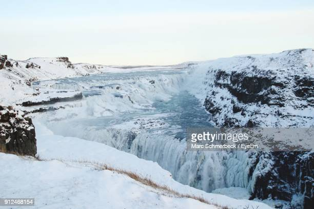Scenic View Of Gullfoss Falls Against Sky During Winter