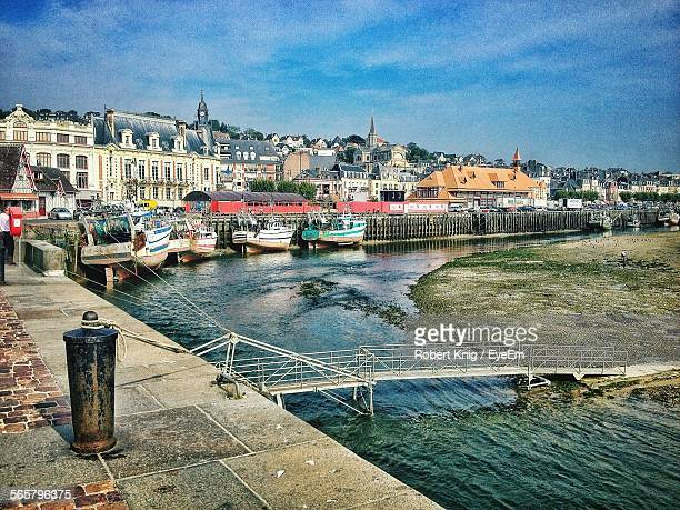scenic view of harbor against cloudy sky - trouville sur mer stock pictures, royalty-free photos & images