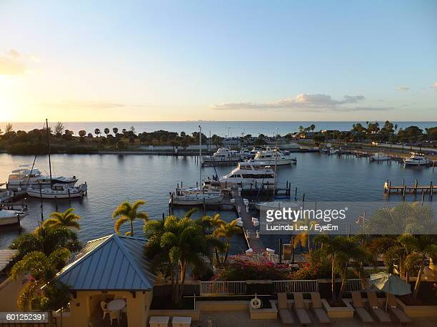 scenic view of harbor and sea against sky during sunset - sarasota stock photos and pictures