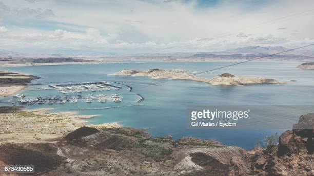 Scenic View Of Harbor In Lake Mead Against Cloudy Sky