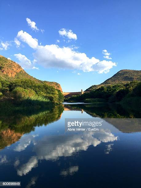 Scenic View Of Hartbeespoort Dam With Clouds Reflection In River