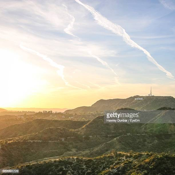 scenic view of hollywood sign on mount lee against sky during sunset - hollywood california stock pictures, royalty-free photos & images