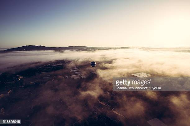 Scenic View Of Hot Air Balloon Over Fog