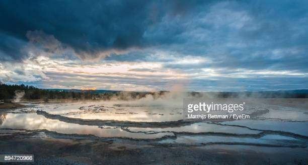 Scenic View Of Hot Spring Against Cloudy Sky