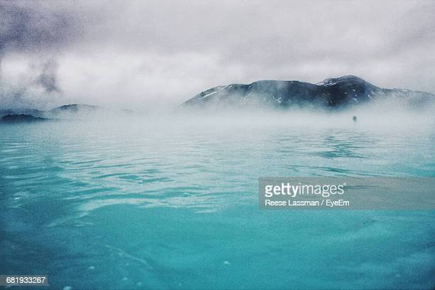 scenic view of hot spring against mountains - hot spring stock pictures, royalty-free photos & images