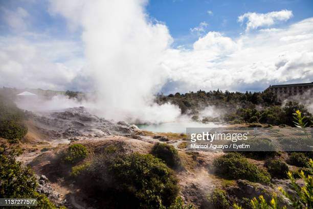 scenic view of hot spring against sky - hot spring stock pictures, royalty-free photos & images