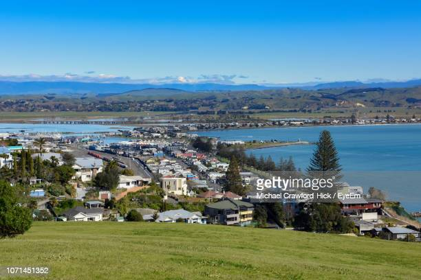 scenic view of houses and buildings against sky - napier stock-fotos und bilder